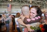 DLM3882  Lance Cpl. P.J. Van Dyk gets a hug from his sister Angi Van Dyk after arriving with...