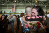 DLM3883  Lance Cpl. P.J. Van Dyk gets a hug from his sister Angi Van Dyk after arriving with...