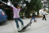 Asha Romeo, 8, left, Dante Seifu Romeo, age 6, center, and Tadu Romeo, 15, play in front of their...