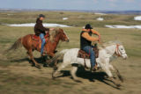 Best friends R.J. LeBeau (cq) left, and Tali Fast Wolf (cq)  ride horses as they check on calving...