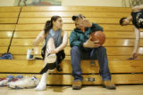 Doug Dupris talks offense as he coaches senior Brittany Azure during practice in the gym at Eagle...