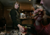 Haley Oser, (cq) bartender serves up drinks to Steve Garner, (cq) from Houston as he smokes his...