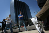 MJM402  Walkers make their way north along Lincoln Street in downtown Denver on their way to the...