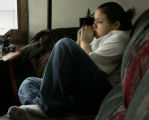 (({Redby,MN} shot on 3/23/05}) At home on the couch Felicia Barron, 17 is spending time to...
