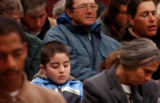 (DENVER, CO. MARCH 25, 20005) (CENTER) Ruger Beltran (CQ. Ruger Beltran), 8, of Denver prays...