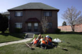 Cub Scouts from Pack 11, centered in northwest Denver, plant a tree on E. Bruce Randolph Ave. in...