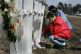 (Red Lake, MN} shot on 3/25/05}) Chanelle Rosebear's mother Sandra Rosebear cries kneeling at a...