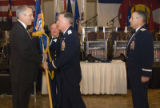 Gov. Bill Ritter, Ritter, left, accepts a guidon/cq/ from Maj. Gen. Mason Whitney as part of a...