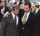L to R: FBI Special Agent Miles Gooderham (cq) and lead prosecutor Cliff Stricklin (cq) exit from...