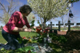Patricia DePooter (cq), mother of Corey DePooter (cq), places flowers for her son at the Columbine...