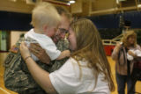 Montana resident, 23 year-old Sarah Cranmore (cq) reunites with her husband and father to 10...