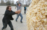 left to right, David Kurtz and Matthew Bryant, (cq both), whack the heck out of the popcorn ball....