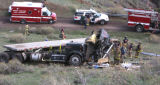 A tractor-trailer lays below the exit ramp to Colorado 8 Monday afternoon April 9,2007. It took...