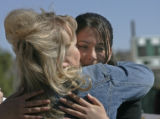 BG0200 Suzanne Craig-McLeod, left, hugs Stacia Mutschler, 16, right, during a press conference at...