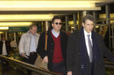 Former CEO of Qwest, Joseph Nacchio,left,  leaves Federal Court Thursday afternoon with his wife,...
