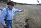 Developer Ron Lewis (cq) throws a stick for his dog, Genghis(cq), at his proposed  Bear Mountain...