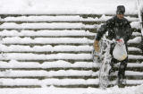 (DENVER, Colo., April 10, 2005) Charles Knox (cq), of Denver, carries his bike down the stairs at...