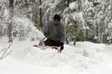(EVERGREEN, Colo., April10, 2005)  Paul Fontana (cq) tries to clear his drive way of the heavy wet...