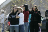 BG0862 Jordan Thayer, CQ, 15, a freshman at Ponderosa High School, left, comforts her mother...
