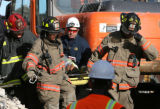 Denver Fire and rescue crews carry out a injured worker from the old Rocky Mountain News building,...
