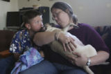 Jerry Monfelt, 10, looks at his mom, Stephanie Monfelt as he kisses Missie and the two say their...