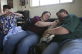 Jerry Monfelt, 10, cries hard and wipes his eyes as his mom Stephanie Monfelt helps comfort Missie...