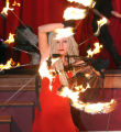 Melinda Rivers (cq) performs with fire, during the opening of a press conference at Elitch...