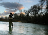 Tony Thai (cq) from Aurora tries his luck at the Platte River on Monday, April 9, 2007 near...