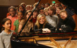 Pianist Mona Golabek, center front, with 6th through 12th grade pianist students Tuesday afternoon...