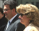 Joe Nacchio (cq) and his wife Anne Esker (cq) exit  the  Alfred A. Arraj United States Courthouse...