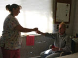 Registered nurse Stacie Mason (cq), left, gives medicine to 51 year old Rudy Ludemann (cq),...