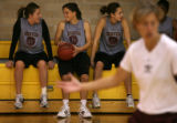 MJM211  University of Denver basketball player, Andie Mason, left to right, talks to teammate,...