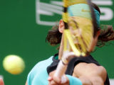MF805 - Rafael Nadal of Spain returns the ball to Thomas Johansson of Sweden during their...