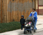 Bonnie Rodriguez (cq), right, takes Josh and Lala, she is baby sitting these children - no last...