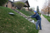Sandra MacDonald (cq), rakes the lawn at her home on South Corona St., Thursday afternoon April...