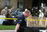 KILZER CAPTION:  Denver fire, police and sheriffs officers search a two story apartment at 4610 E....