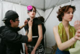 Designer Armando Guerra (cq), left, puts together the dress he designed on model Chelle Kay (cq),...