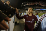 DLM5265  Colorado Rapids defender Nicolas Hernandez high fives the fans in the south stands before...