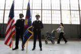 DLM5704  Stacey Kimberly walks behind Denver Police Honor Guard members Keith Spooner, left, and...