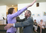 Sarah Libert (cq) gives 78 year-old Don Scheuer (cq), a hug, as he is retiring as assistant...