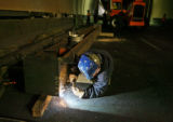 Pat Stevens (cq) does some arc-welding on a steal beam, Friday morning, April 27, 2007, inside the...