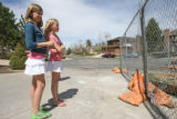 (from left) 11 year-old Emily Martinek (cq) and her 11 year-old friend Bryn Larson (cq) look over...