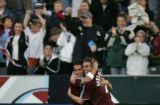 Colorado Rapids players Herculez Gomez, left, and Nicolas  Hernandez celebrate Gomez' goal against...