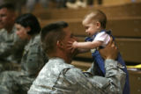Sgt. Scott Rayl, cq, of Colorado Springsplays with his youngest child Jacob Rayl, 7 months before ...