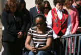 Carleen Johnson (cq), center - front, takes part in a moment of silence and bell ringing, Friday...