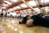 An exhausted R.J. LeBeau from the Cheyenne River Reservation in S.D. , catches a nap during the ...