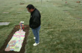 Larry Gonzales (cq), looks down on the grave of his grandson, Dominic Gonzales (cq), who was...