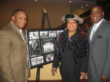 Brothers Jay, left, and Damon Barry, and their mother, Glenda, recreate the photograph on display...