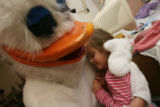 Kyler Caldwell, (cq), 3, gets a hug from the duck in her room in the hospital. The Easter Bunny,...