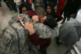 (DLM2261) -   Army Sgt. Jose Torres of Englewood hugs his wife Stephanie after flying in during...
